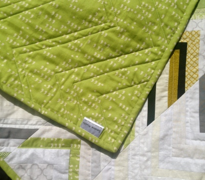 Corner of the chevron quilt with the tag